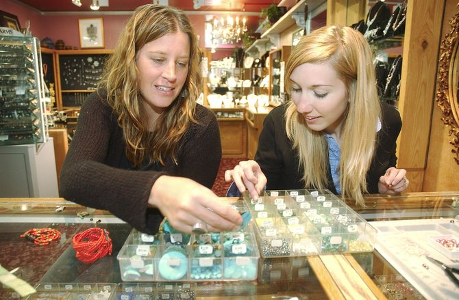 Steamboat Springs residents Jenn Gallagher, left, and Julie Friese pick through beads while making jewelry Wednesday at Silver Lining in Torian Plum Plaza at Ski Time Square.