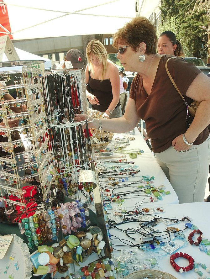 Connie Minkoff of Billings, Mont., looks at jewelry Saturday morning during the Farmers Market in downtown Steamboat Springs.