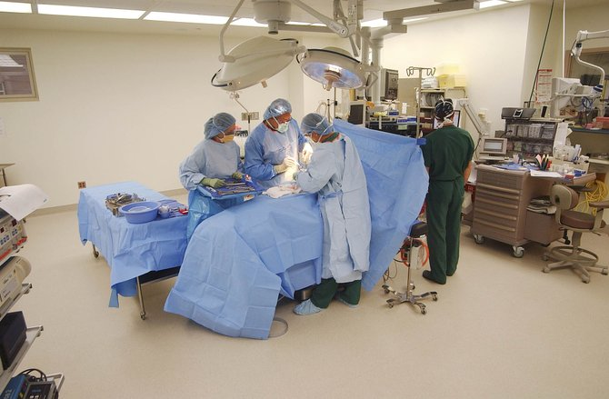 Doctors perform a hip surgery last month at Yampa Valley Medical Center. Wednesday is National Time Out Day, a day created to raise public awareness of the measures hospitals take to prevent surgical errors.