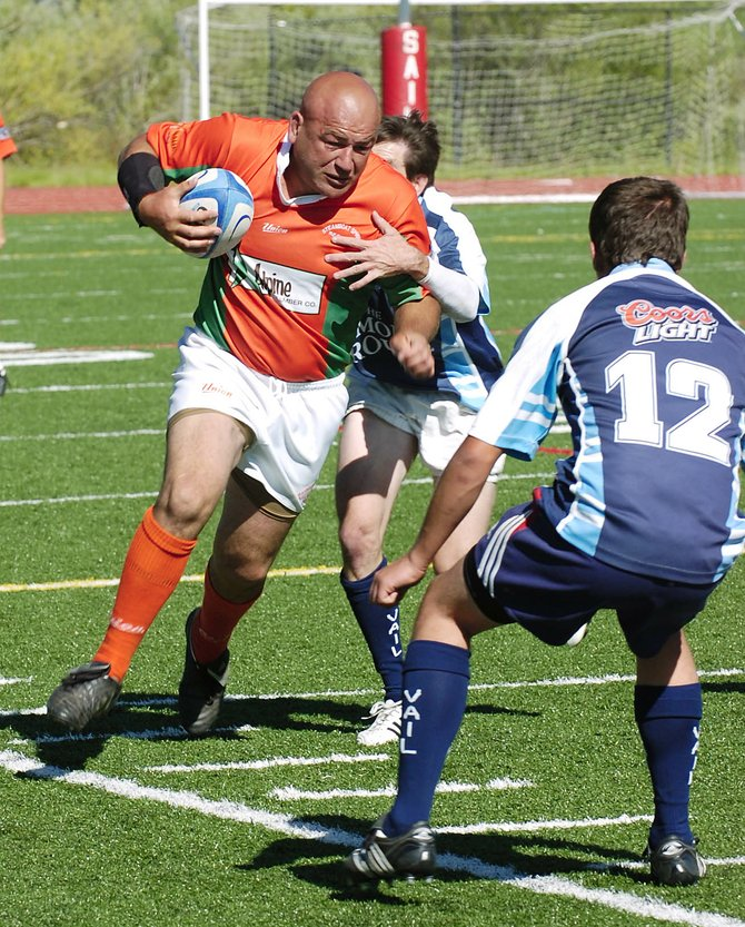 Steamboat Springs rugby player Graham Muir advances the ball up the pitch Saturday at Steamboat Springs High School's  Gardner Field.