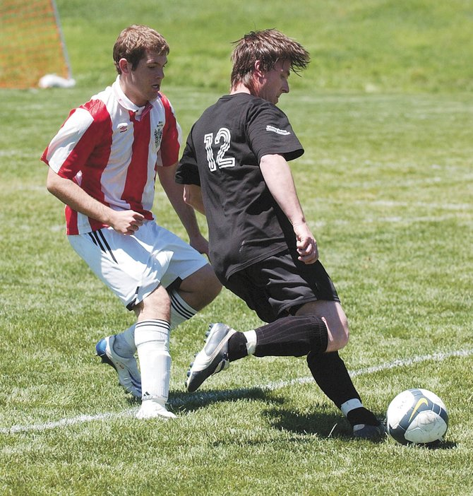Steamboat Springs men's soccer player Rusty Davison gets ready to pass the ball Saturday afternoon during Steamboat's match against Vail at Christian Heritage School.