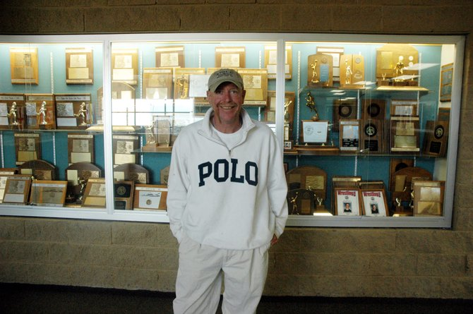 Rick Penner, the new Moffat County High School athletics director, poses in front of the Bulldogs trophy case on the second floor of the high school. Penner visited Craig today to be introduced to the MCHS staff.