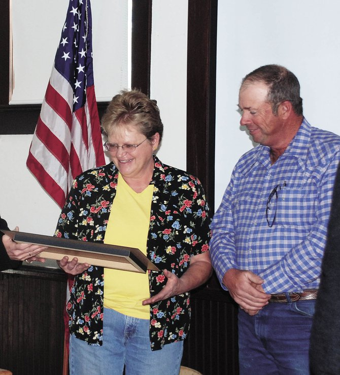 Judy and Jim Kendall were recognized by Historic Routt County for maintaining one of the oldest occupied homestead cabins in the valley. Their home is on Yellowjacket Pass on the way to Stagecoach. Newspapers originally used as insulation in the cabin dated to 1898.