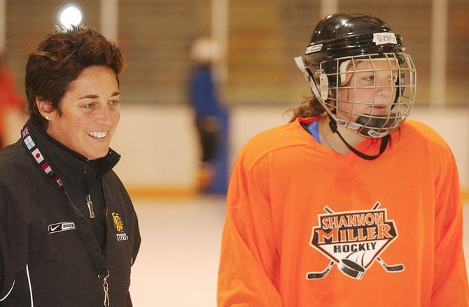 University of Minnesota - Duluth hockey coach Shannon Miller, left, talks to 15-year-old Alexis Stabile of Steamboat Springs on Wednesday during the Shannon Miller Hockey Camp at Howelsen Ice Arena.