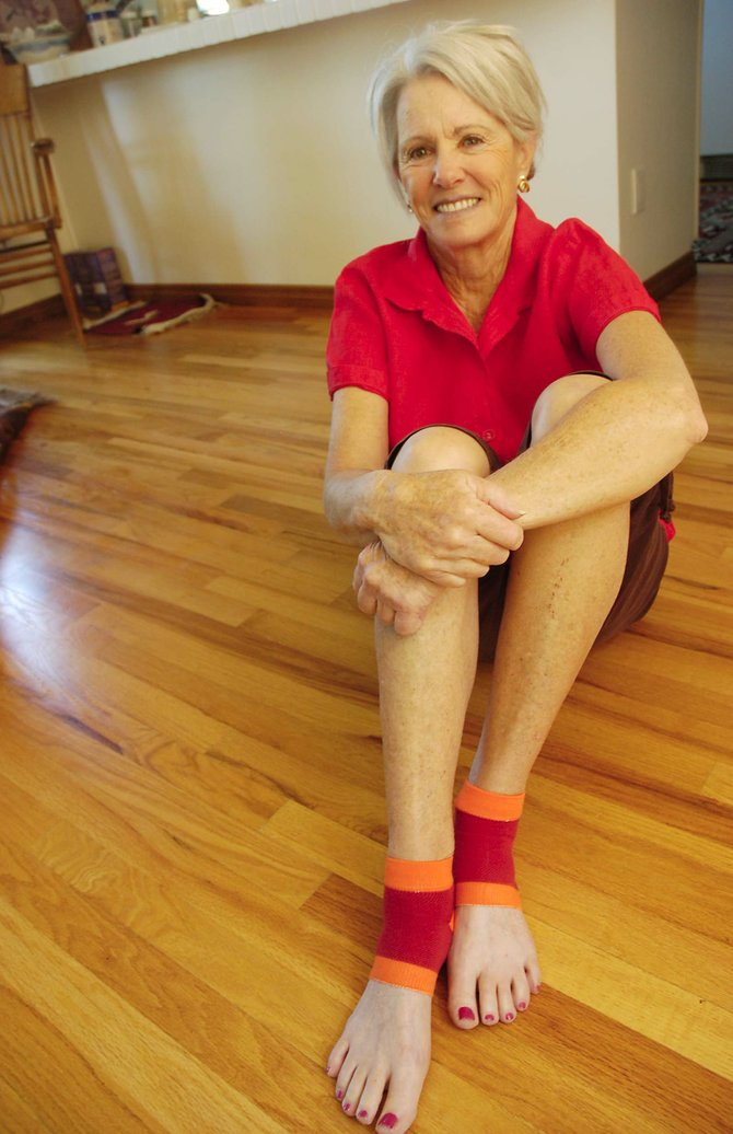 Part-time Steamboat resident Arlene Austin models the Pseudosoc, half-socks made of nylon and spandex.