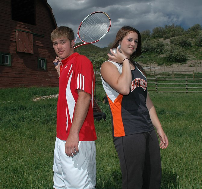 Routt County Athletes of the Year Ramsey Bernard, left, and Holli Salazar pose on the farm of Greg and Gail Haight near Steamboat Springs. Bernard, a senior at Steamboat Springs High School, dominated his way to the Class 4A No. 1 singles state title, winning the tournament without dropping a set. Salazar, who was a junior at Hayden High School, won the Class 2A state shot put championship. She also earned all-league honors in basketball and volleyball.