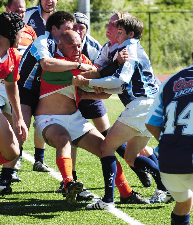 Steamboat Springs rugby player Graham Muir is surrounded by Vail opponents June 14 at Steamboat Springs High School's Gardner Field. Steamboat takes on Aspen at 3 p.m. today.