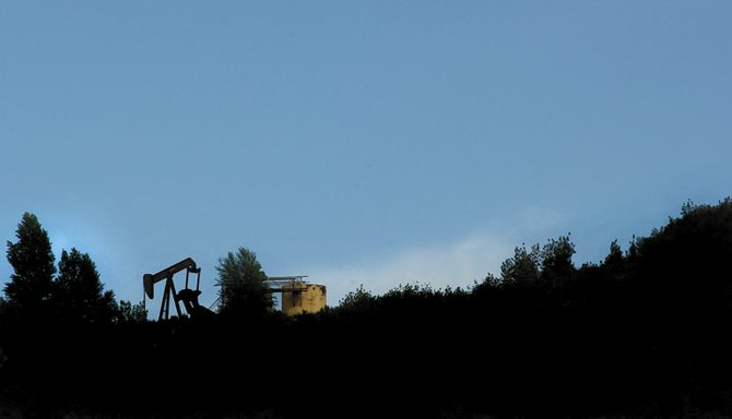 Oil extraction equipment is silhouetted on this ridge line that runs alongside U.S. Highway 40 just outside of Milner in West Routt County. Recently, a Texas-based limited liability company paid about $30.5 million for sub-surface mineral rights in the area - a sign of expanded interest in oil exploration in the county.