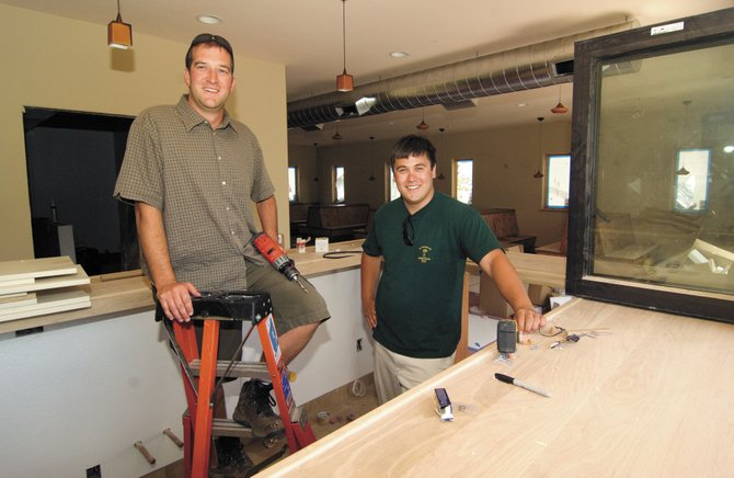 Joe Schuetz, left, general manager of Boat House Pub, and business partner Ryan Ulep are hoping to have the downtown bar and restaurant open in mid-July.