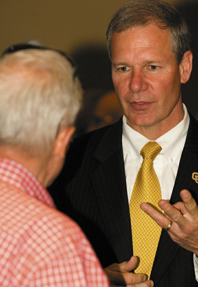 "University of Colorado Chancellor G.P. ""Bud"" Peterson chats with members the Rotary Club of Steamboat Springs during its weekly lunch meeting at the Steamboat Grand Resort Hotel. Chancellor Peterson addressed the universities Flagship 2030 plan and the future of the CU campus while speaking to the group."