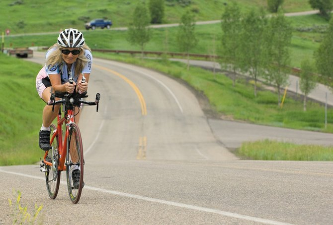 Steamboat endurance athlete Bonnie Herter takes a training ride along Amethyst Drive near the Strawberry Park school campus this week. Herter is preparing for the Danskin Women's Triathlon in Aurora on Sunday.