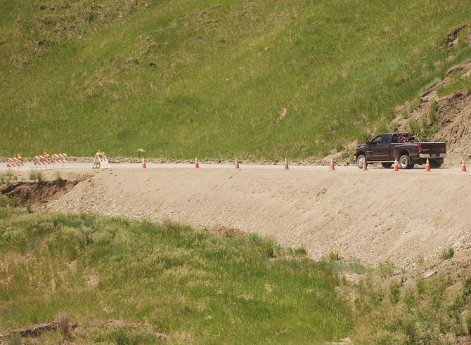 A truck drives along Routt County Road 76 on Tuesday near Hayden. Residents have complained for months about damage that has occurred to the road as a result of annual slides.