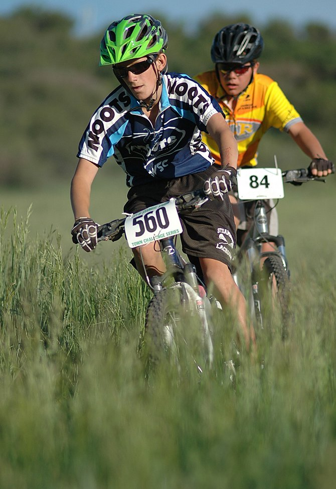 Wesley Park, 13, from Steamboat Springs, holds a slight lead against Zeb Tipton, 14, near the end of Wednesday's Steamboat Springs Town Challenge mountain bike race at the Marabou ranch subdivision west of Steamboat.
