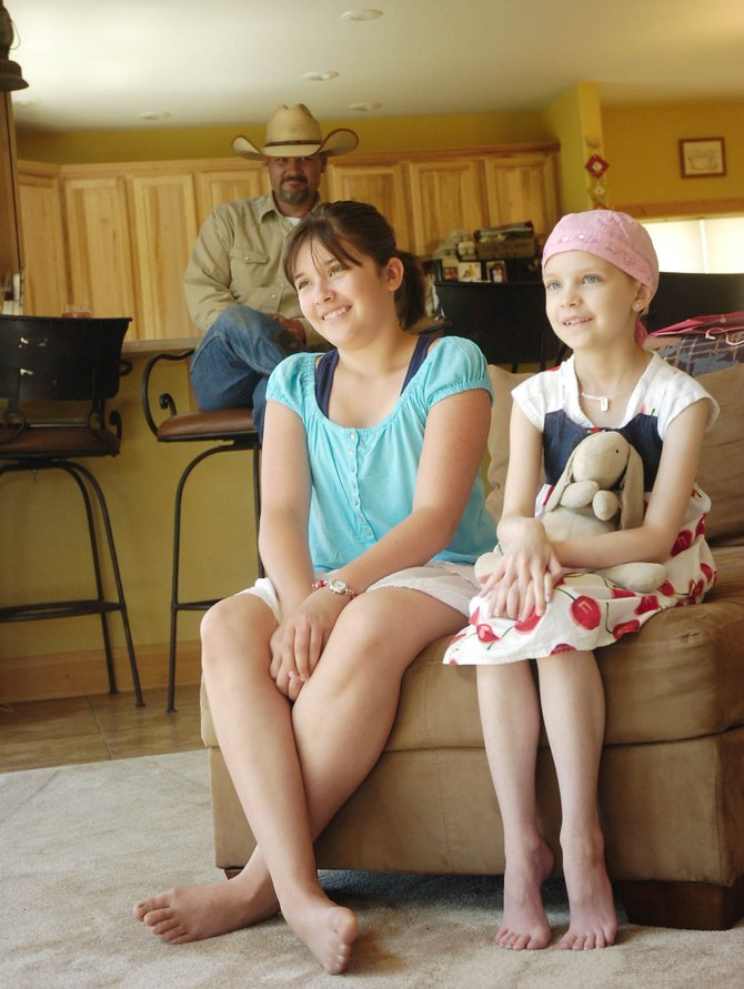Eight-year-old Taylen Zabel, right, with her older sister, 12-year-old Tyanna, at their home. Taylen was diagnosed with medulloblastoma, a malignant brain tumor, on April 9, 2007. After several months of healing, she is finally done with chemotherapy.
