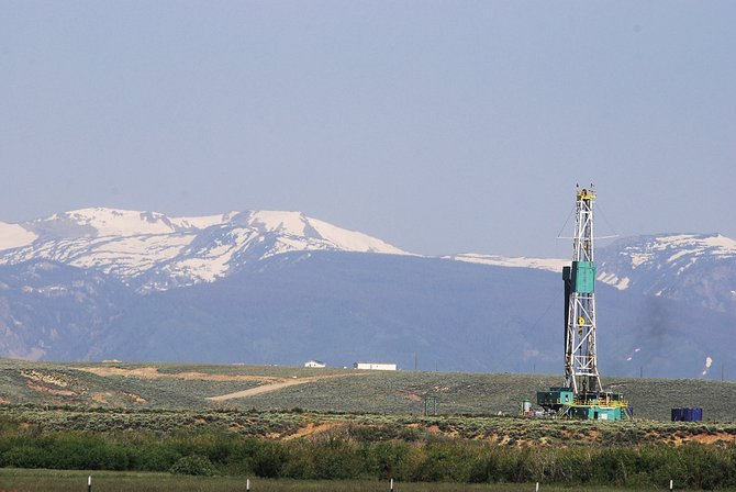 Houston based EOG Resources is undertaking exploratory drilling for oil in Jackson County, where Mt. Ethel and other peaks in the Mount Zirkel Wilderness Area loom in the background.