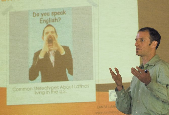 Dave Slade, president of Lanza Language, speaks during a Hispanic Cultural Awareness meeting Friday at the community center in Steamboat Springs.