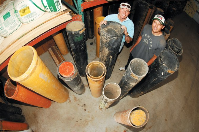 Tim, left, and Scott Borden stand among the many large circular mortars that will be used to launch fireworks into the air at this year's Fourth of July holiday celebration at Howelsen Hill.