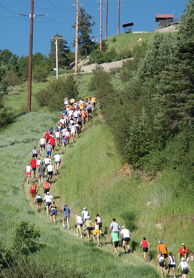 Runners make their way up Howelsen Hill for the first lap of the U.S. Trail Running National Championship on Sunday in Steamboat Springs. Youth and women runners made two loops on the course while men made three.