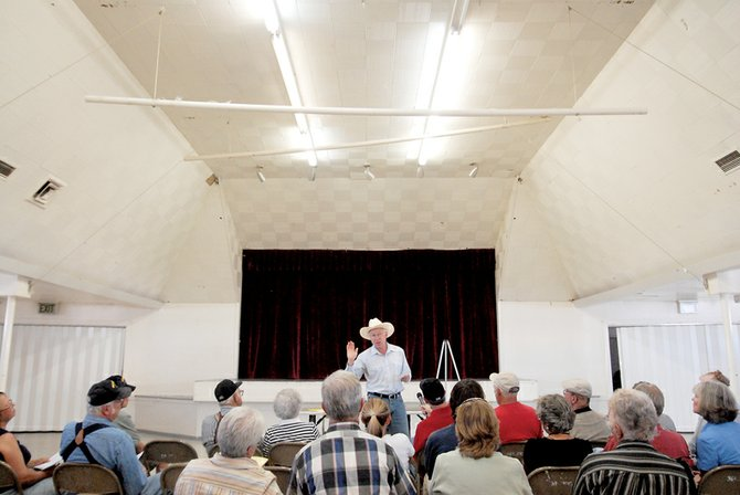 U.S. Sen. Ken Salazar, D-Colo., speaks to Moffat County residents Thursday at the Moffat County Fairgrounds Pavilion. Salazar came to speak about the 2008 Farm Bill and answered questions ranging from energy policy to immigration.