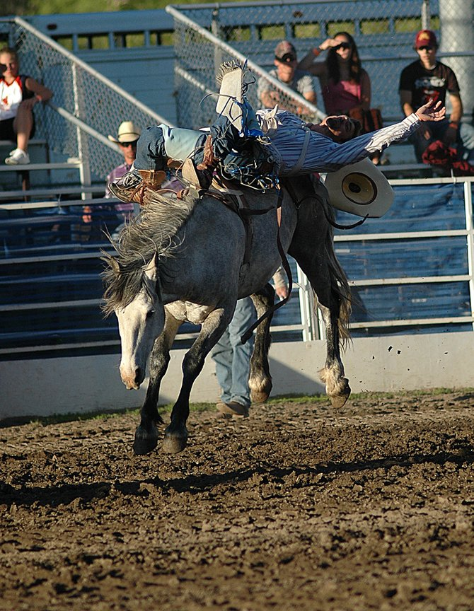 A cowboy loses his hat during the bareback riding competition ealier this season at the Steamboat Springs Pro Rodeo Series. The rodeo returns to Steamboat for its fourth weekend, starting at 7 p.m. today.
