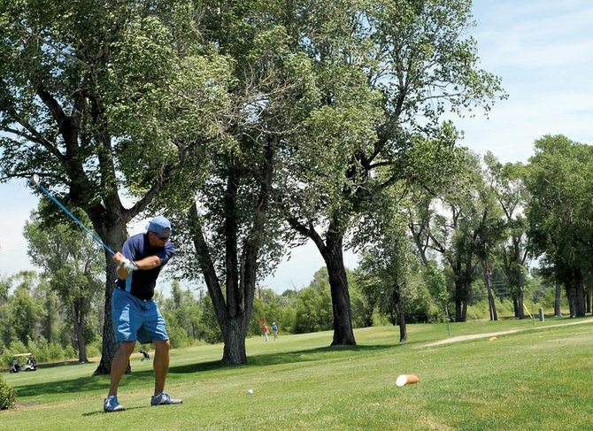 Pete Heuer, of Hayden, tees off on the first hole of the Cottonwood Classic golf tournament at the Yampa Valley Golf Course. Heuer played in the second flight.