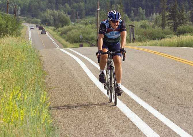 The double set of stripes didn't seem to confuse John Dorman as he rode his bike along Routt County Road 36 on Monday afternoon. The contractor working for Routt County striped the road in the morning, but crews mistakenly striped over the existing 9-foot lines instead of widening the driving lane to 10 feet.