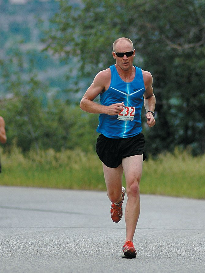 Todd Trapp fights his way up Aspen Ridge Road on Sunday during the Mountain Madness half marathon. Trapp won the event in 1 hour, 15 minutes and 40 seconds.