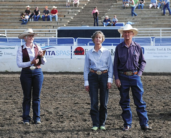 Three families were on hand Sunday to receive 2008 Heritage Family Awards at the Ranch Rodeo in Steamboat Springs. Marsha Daughenbaugh, Community Agriculture Alliance executive director, left, prepares to hand the plaque to Judy and Jerry Green of the Hayden area. Jerry Green's family homesteaded south of Hayden in 1895, and the pair now run the ranch.
