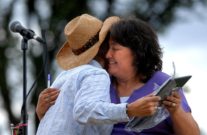 Vicki McPhail, left, recognizes Pauline Hillard with a hug and a plaque at the Relay for Life in Rangely in 2006. This year marks the second time the Relay for Life will take place in Craig.