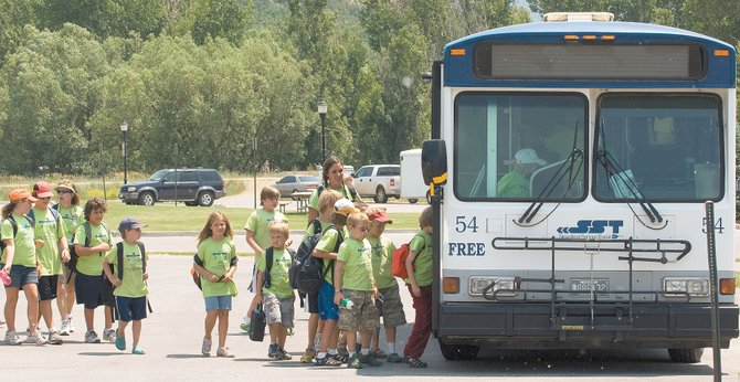 A large group of young riders boards a bus at Stock Bridge Transit Center on Friday afternoon. Steamboat Springs Transit is experiencing a record year in ridership, which is up 15 percent from last summer.