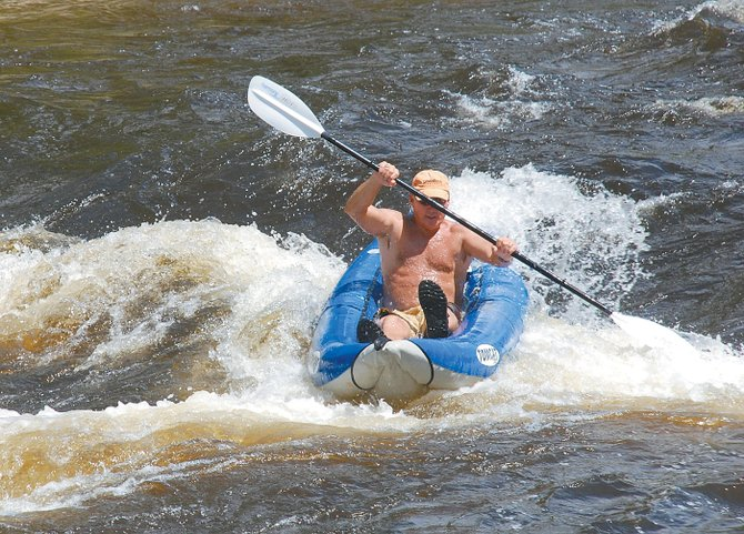 Jeff Little, of Steamboat Springs, finds cheap thrills on the town stretch of the Yampa River this week.