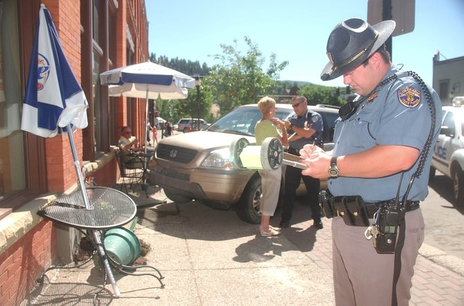Colorado State Patrol Trooper David Kerker reconstructs an accident that occurred Saturday in front of Azteca Taqueria on Ninth Street.