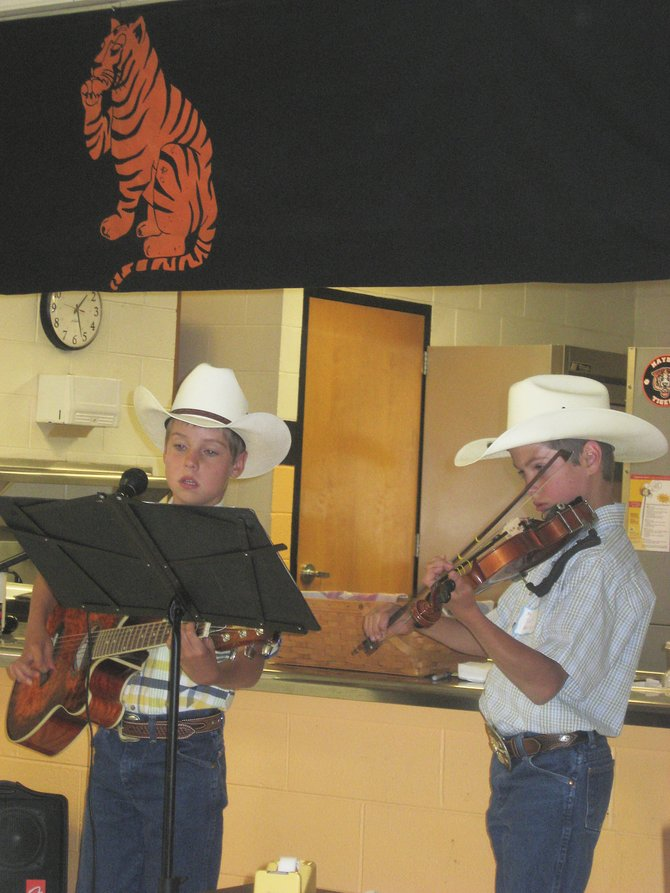 Young musicians shared their talent with a mostly older audience Sunday at the Pioneer Picnic at Hayden Middle School. Ten-year-old Kearn Gerber, left, and his brother Tyler, 12, played classic folk songs.