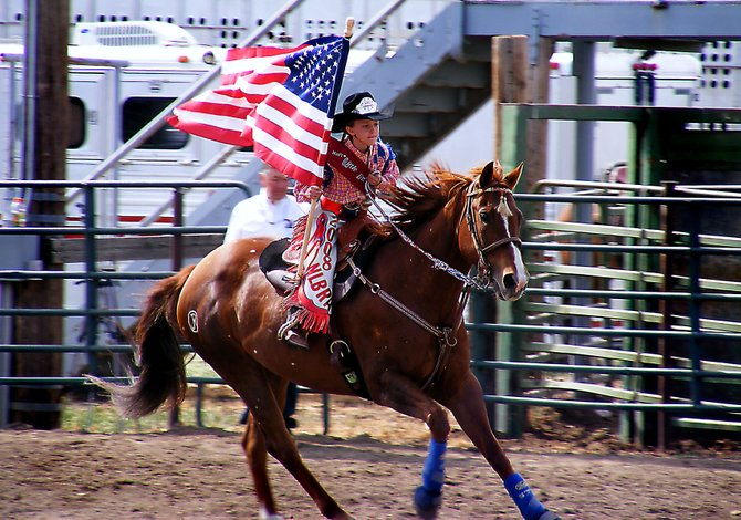 Craig resident, and Little Britches National Rodeo Association Little Wrangler princess, Kinlie Brennise rides her horse, Martha, during the opening ceremonies of a NLBRA event May 23 in Hotchkiss. Brennise ends her yearlong reign Aug. 28 during the National Finals in Pueblo.