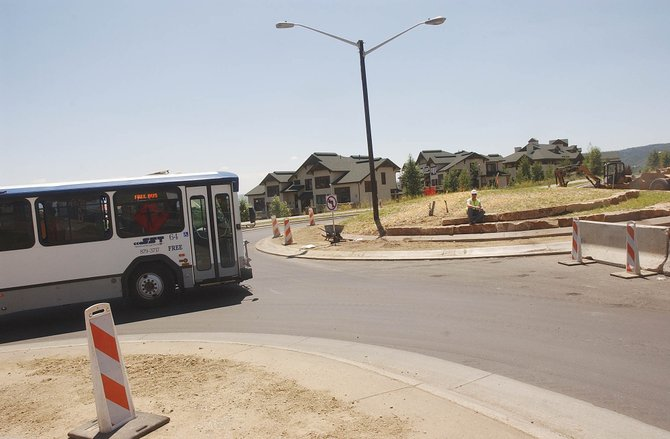 A city bus maneuvers the new roundabout intersection at Mount Werner Circle and AprÃs Ski Way on Tuesday.