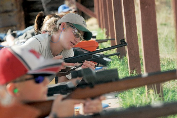 Justin Willems, 15, lines up with other 4-H Sharp Shooters on Thursday at Bears Ears Shooting Range. This is Willems' third year with the Sharp Shooters.