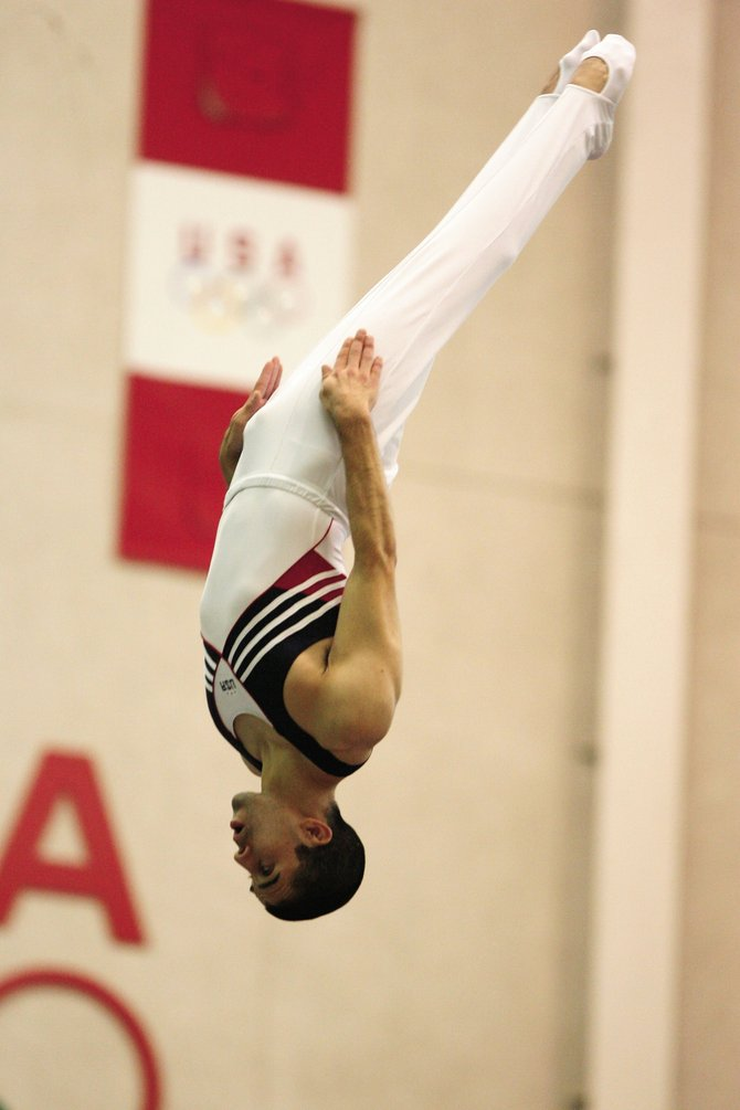 American Olympic trampoline hopeful Chris Estrada practices his form at the U.S. Olympic Training Center in Colorado Springs. Estrada, whose parents live in Clark, will be the first American male to compete in the sport on the Olympic stage next month in Beijing.