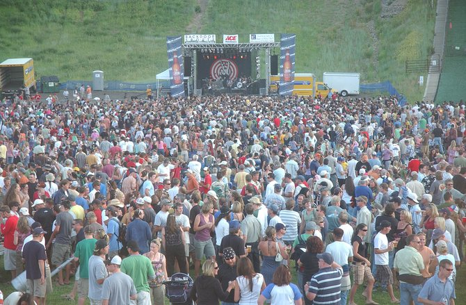 Steamboat Springs residents attend a free summer concert featuring Michael Franti and Spearhead at Howelsen Hill.