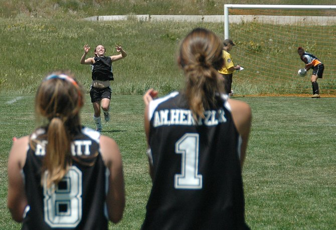 Elycia Orth from the Englewood Eagles ESC Premier U16 team races toward her teammates after scoring the decisive penalty kick in a game Saturday against Littleton United Blue.