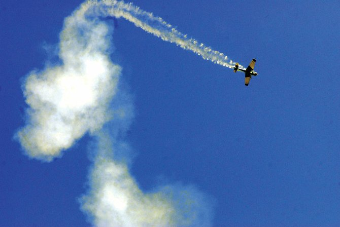 An Edge 540 whips through the air Saturday during the Craig Centennial AirFest at Craig/Moffat County Airport. The plane was controlled by Charlie Williams during the remote control air show.
