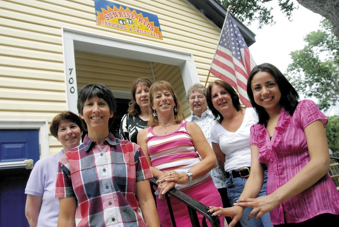 Staff of Sunrise Kids, LLC, Preschool & Child Care, stand in front of the school Friday. In the front row, from left, are Donna Secules, Judi Whilden and Adriana Carrillo, and in the back row, from left, are Maureen Crawford, Kimberly Swenson, Pat Coyner and Jean Shelton.