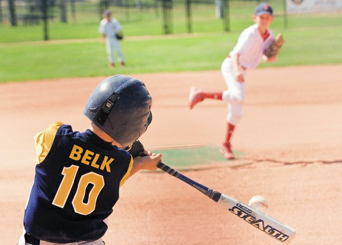 James Belk puts the bat on the ball during the opening day of the Triple Crown World Series in Steamboat Springs on Monday afternoon. Belk was playing for the Colorado Crush baseball team out of Fort Collins.