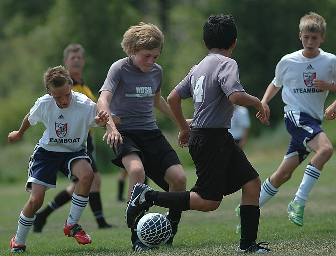 Steamboat Springs soccer player Mitch McCannon shoves his way to the ball Sunday at the Emerald Park soccer complex in Steamboat. The Steamboat U-11 boys soccer team beat the Colorado Rush, 2-1, to win its bracket in the Steamboat Mountain Tournament.