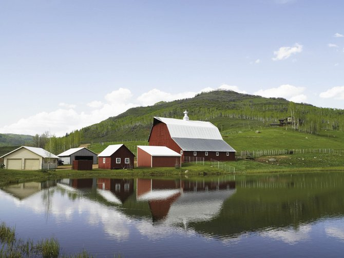 The 4,300-acre Big Creek Ranch off Elk River Road includes an 11,000-square-foot lodge, a 100-year-old barn and the potential to develop many more ranch estates. Below: The ranch also contains four miles of private trout stream. Of a total 4,300 acres, about 2,000 acres are under a conservation easement.