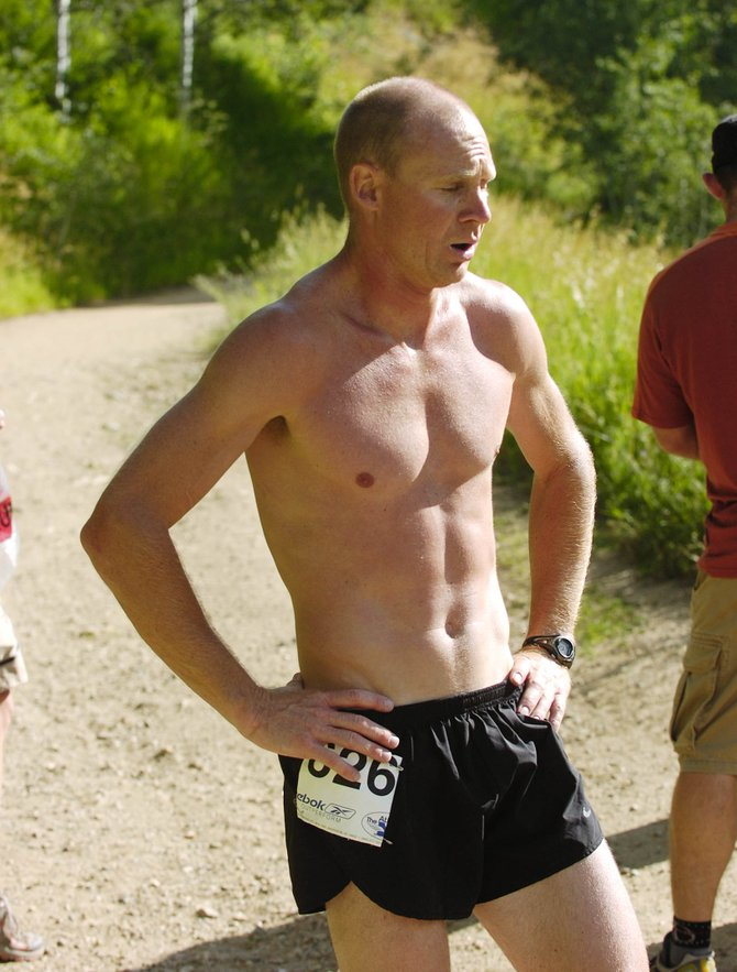 Todd Trapp catches his breath after finishing the Spring Creek Memorial run Saturday morning.