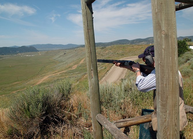 Steamboat Springs resident Bill Yowell takes aim at a clay pigeon Sunday morning at the Three Quarter Circles Sporting Clays range west of Steamboat. The ranch features 12 shooting sites and a wide variety of shots with a range of difficulty levels.