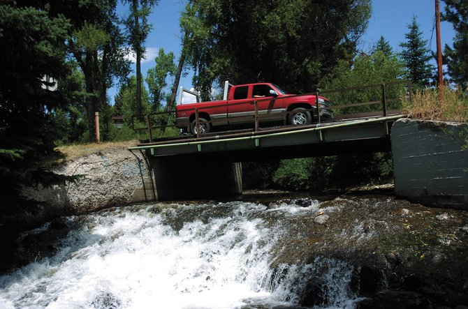 A truck drives over the Yahmonite Bridge on Tuesday afternoon. The bridge will be closed to through traffic this week while waterline work is done.