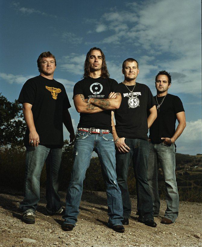 Cody Canada, center, says Cross Canadian Ragweed has stayed independent in its 14 years of playing, as the band has used gritty country rock shows to garner support for audiences and a major label.