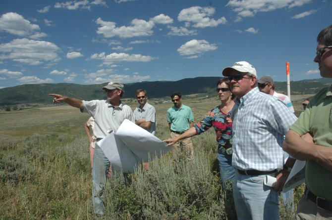 Land-use consultant Peter Patten, left, points out boundary lines of the proposed Steamboat 700 development Thursday. At right, in the hat, is Steamboat Springs City Councilman Steve Ivancie, then council members Meg Bentley, Loui Antonucci and Scott Myller. The pole in the background marks the city's Urban Growth Boundary.