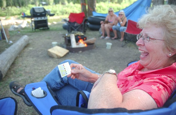Rosie Kirven of Aurora laughs while reading the answer to a trivia question Wednesday evening at Steamboat Campground. Kirven was staying at the campground, while her grandson played in the Triple Crown Sports baseball tournament.